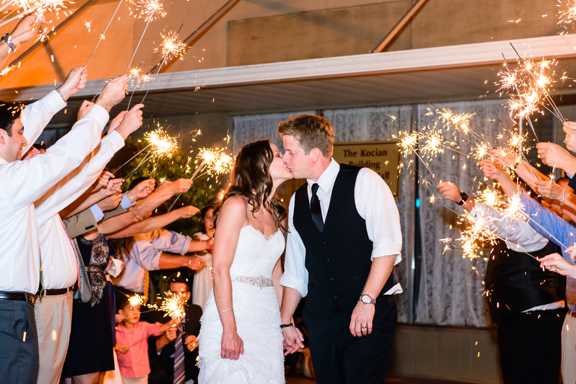 Austin-Wedding-Photographer-Sparkler-Exit-Kissing
