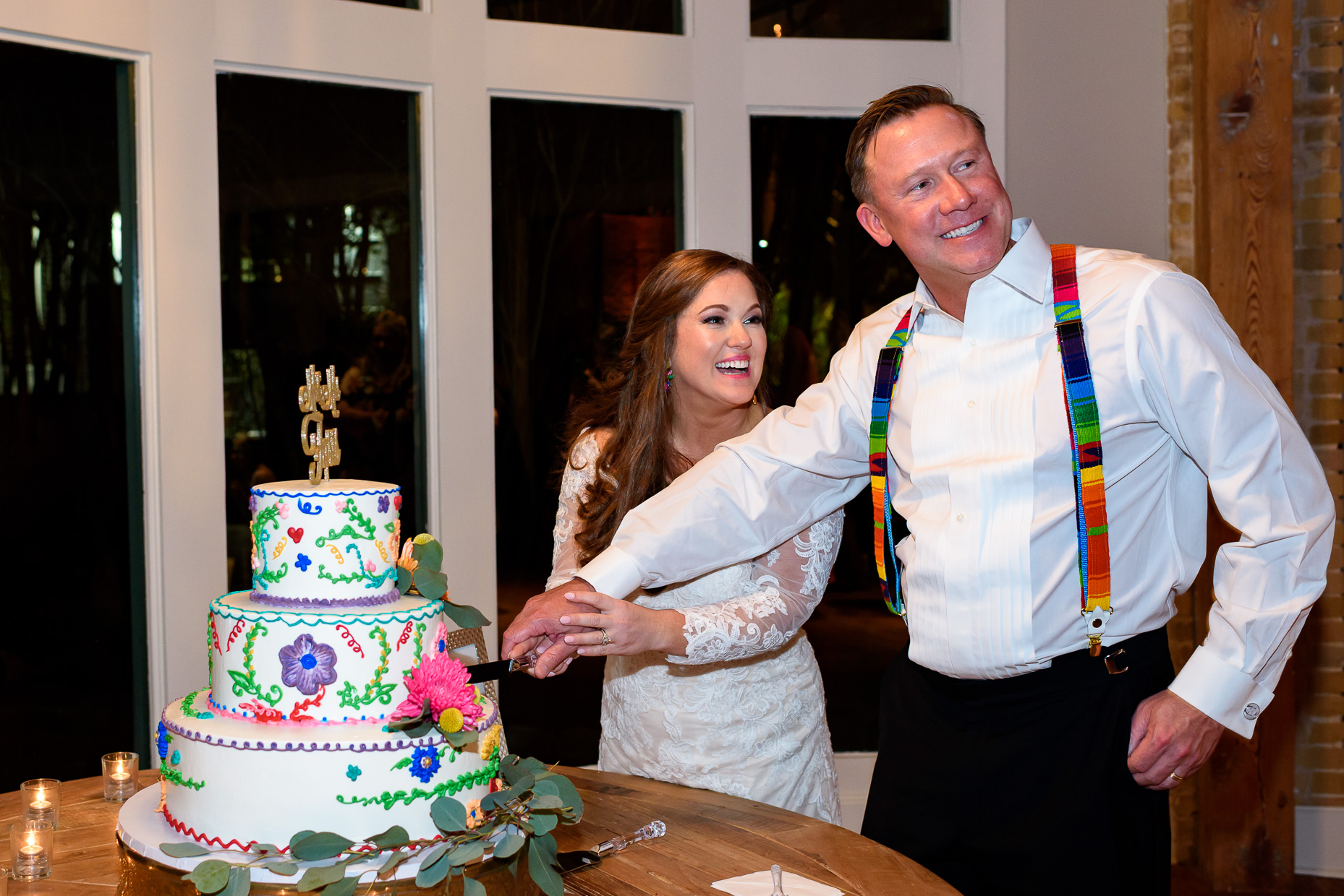 Austin-Wedding-Photographer-cake-cutting-suspenders-zaza-gardens-san-antonio