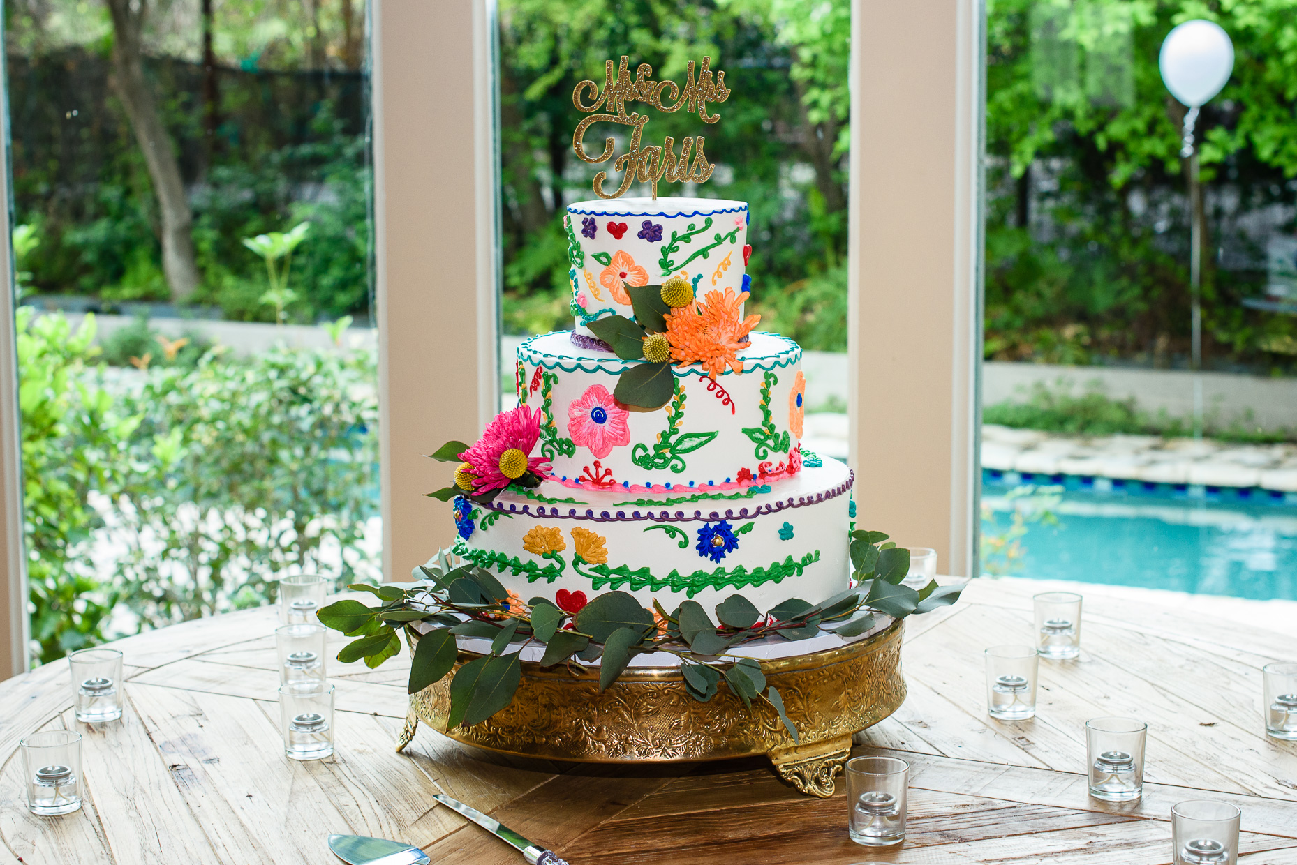 Austin-Wedding-Photographer-cake-flowers-glitter-colorful-tiered-topper