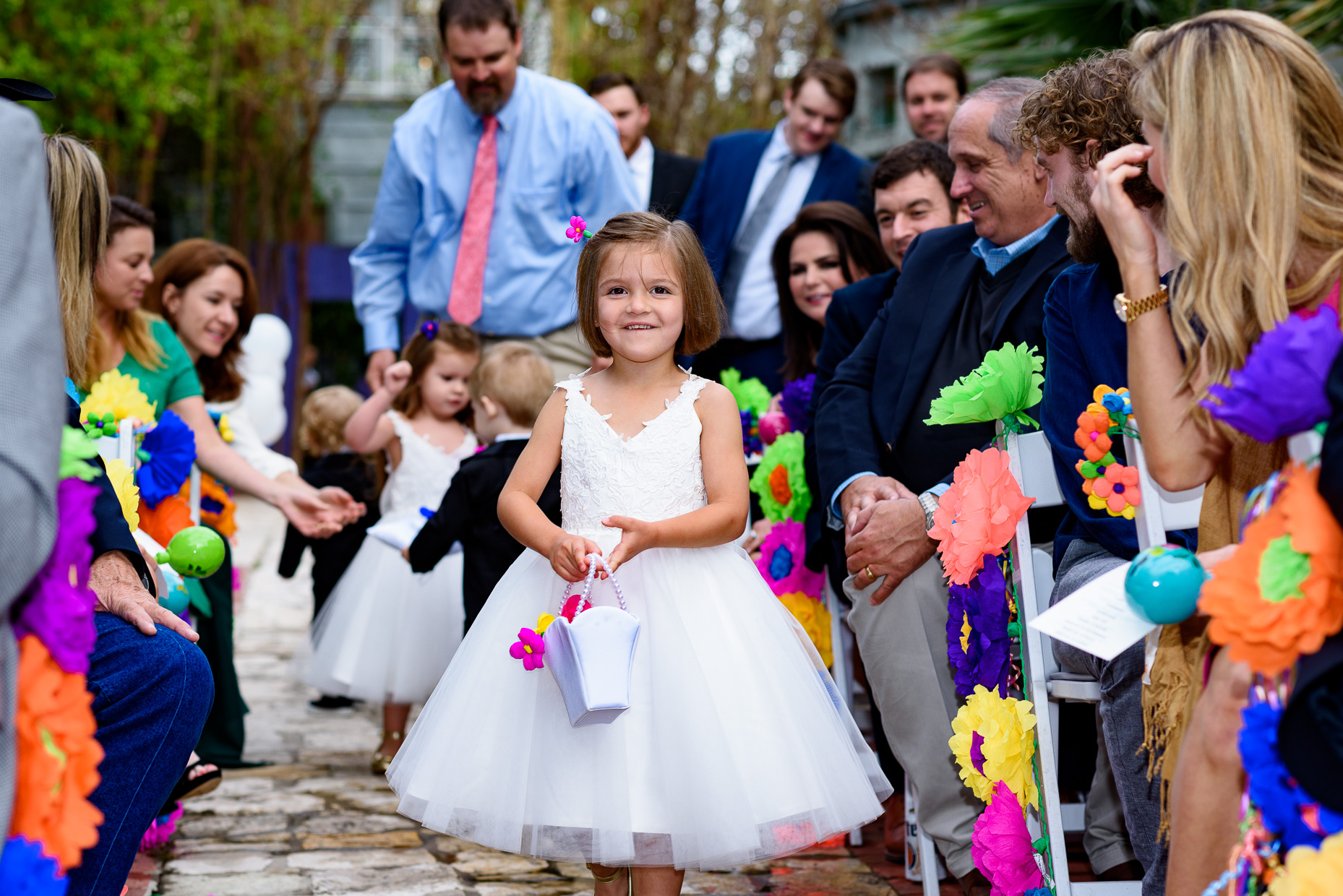 Austin-Wedding-Photographer-ceremony-flower-girl-paper-colorful-zaza-gardens