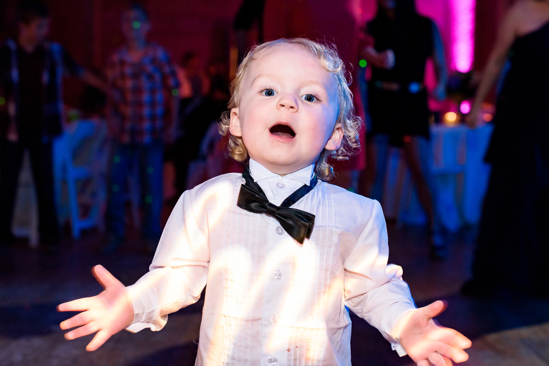 Austin-Wedding-Photographer-kid-reception-tux-funny-colorful