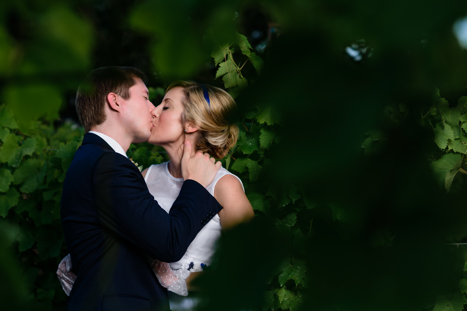 bride-groom-kissing-austin-wedding-photographers-vineyards-texas-love