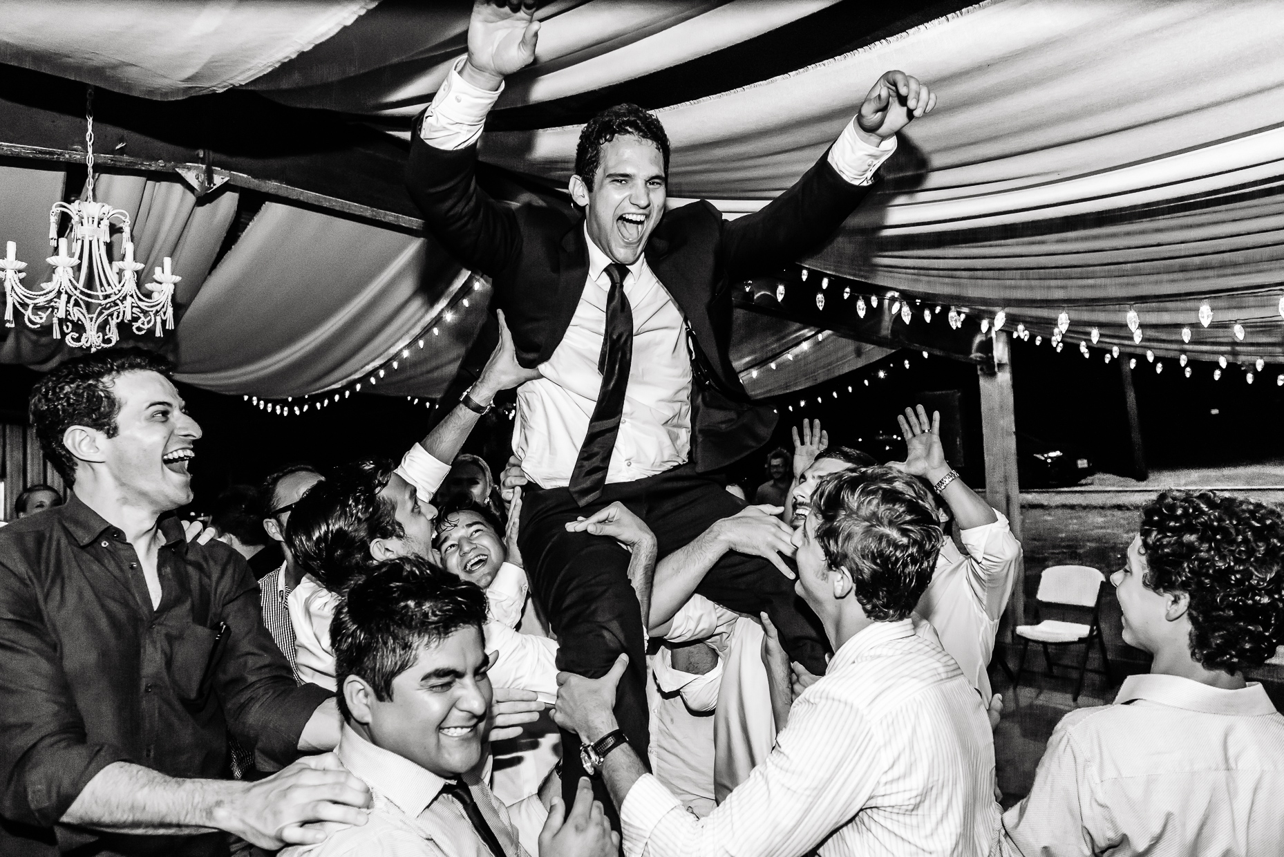Austin-photographer-wedding-reception-texas-groom-lifted-dancing