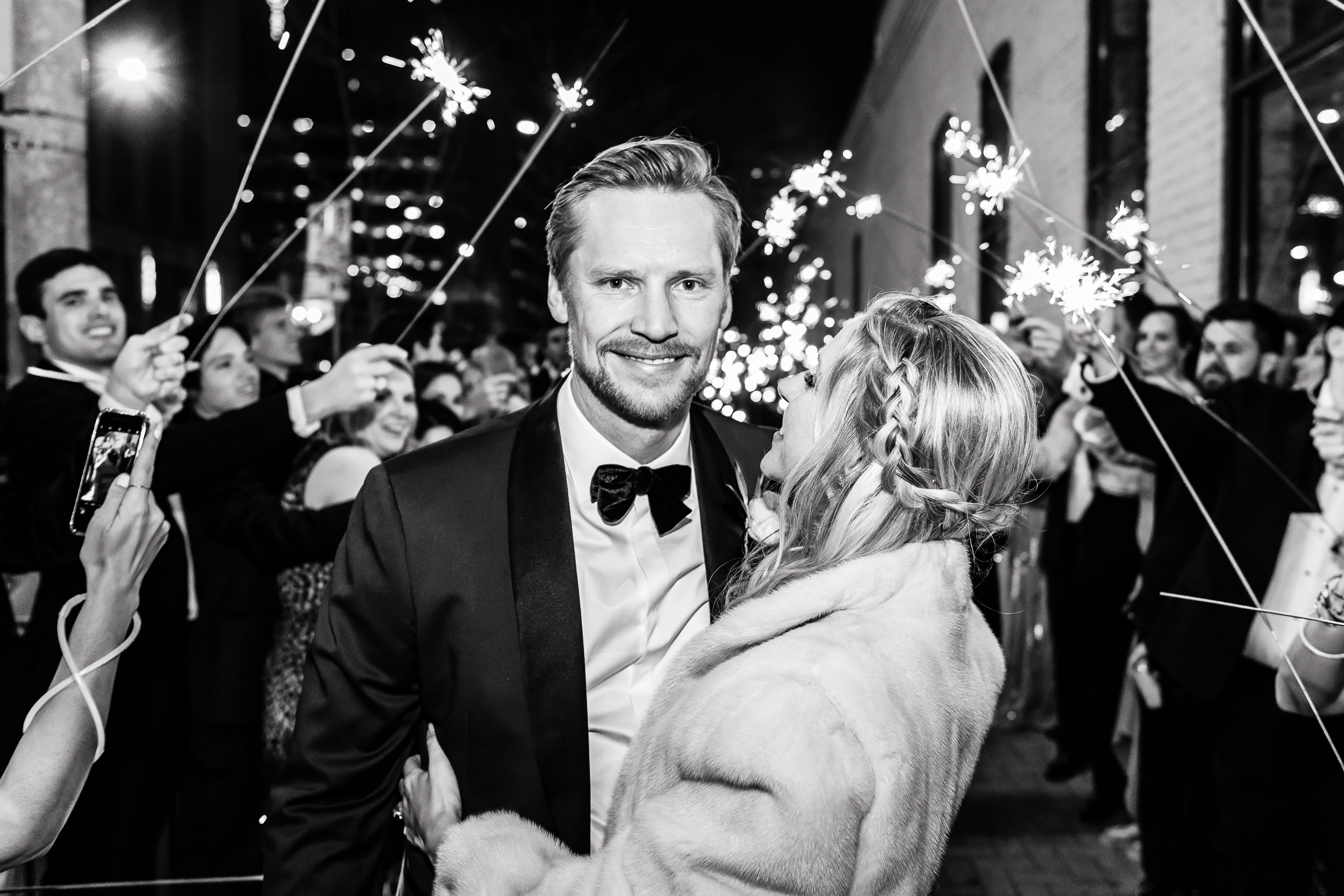 Austin-wedding-photographers-brazos-hall-downtown-exit-sparklers-sidewalk-fur-jacket-tuxedo