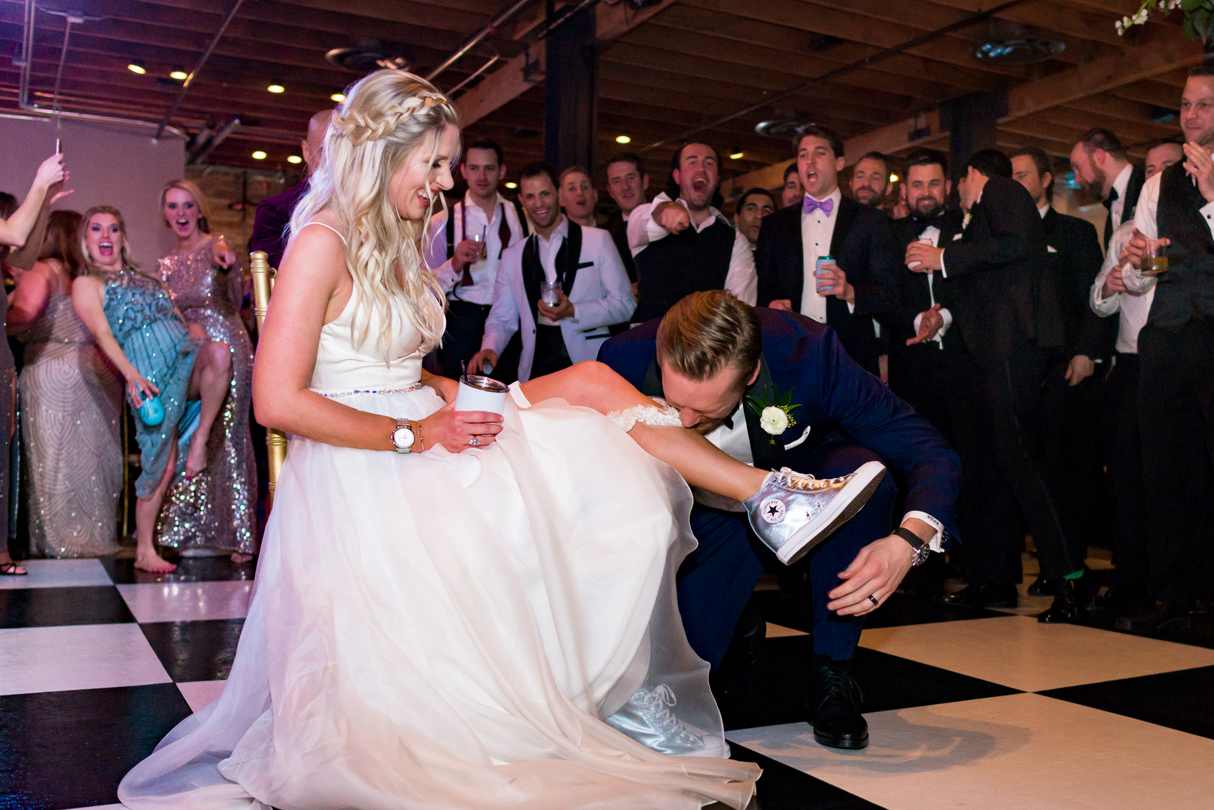 Austin-wedding-photographers-brazos-hall-downtown-reception-garter-groom-converse-dress