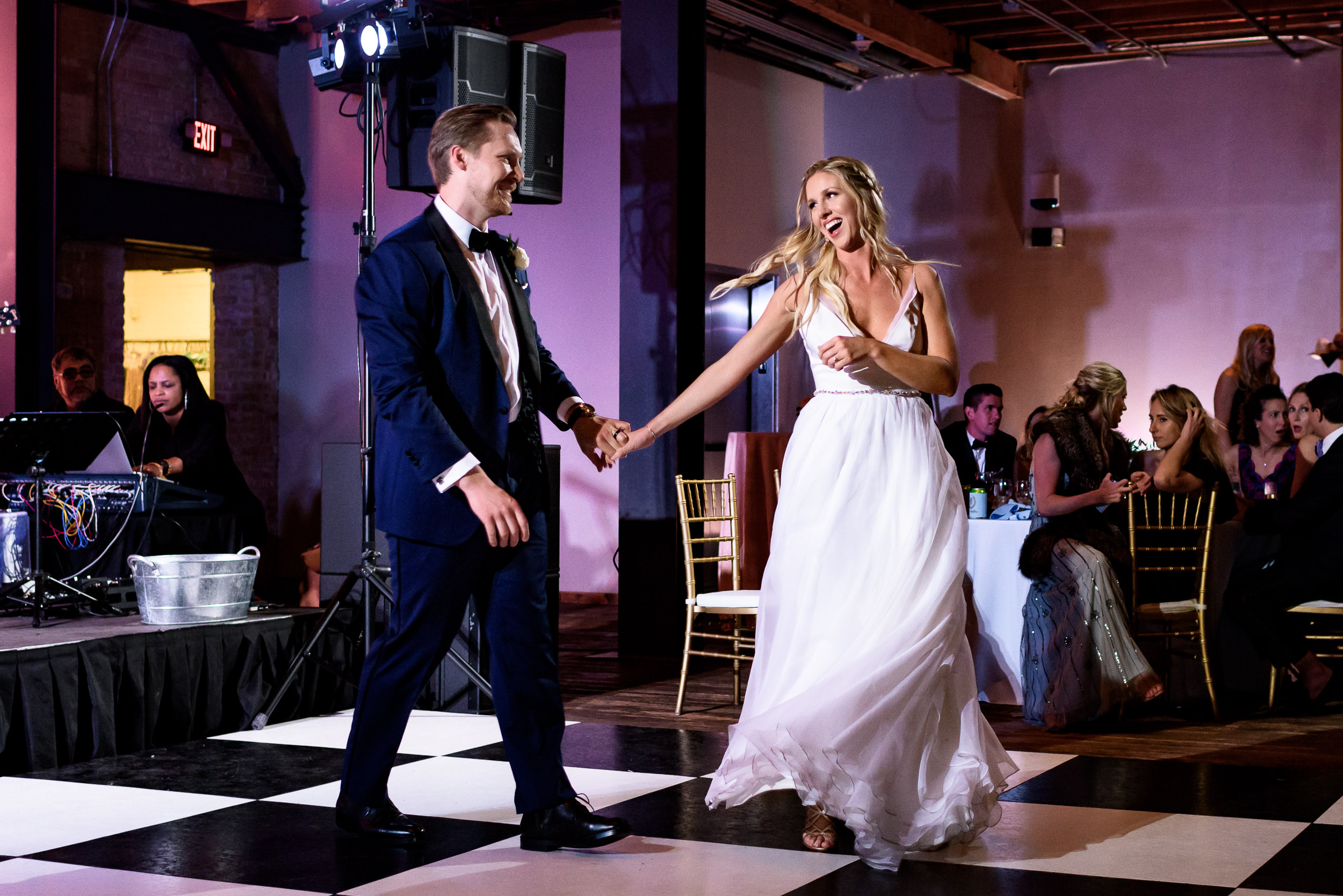 Austin-wedding-photographers-purple-uplighting-brazos-hall-downtown-twirl-first-dance