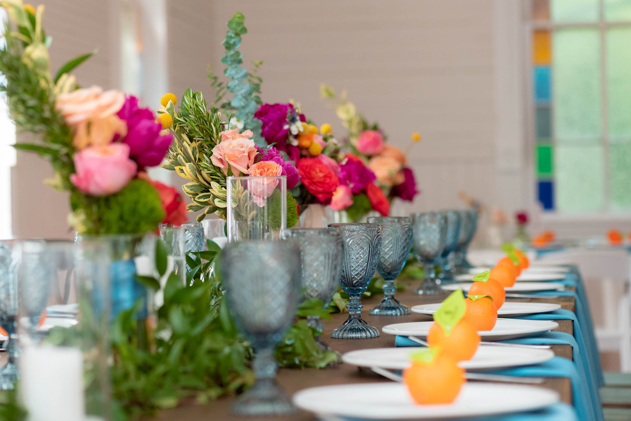 Mercury-Hall-Austin-Wedding-Photographers-texas-flowers-table-setting-blue-glasses-oranges