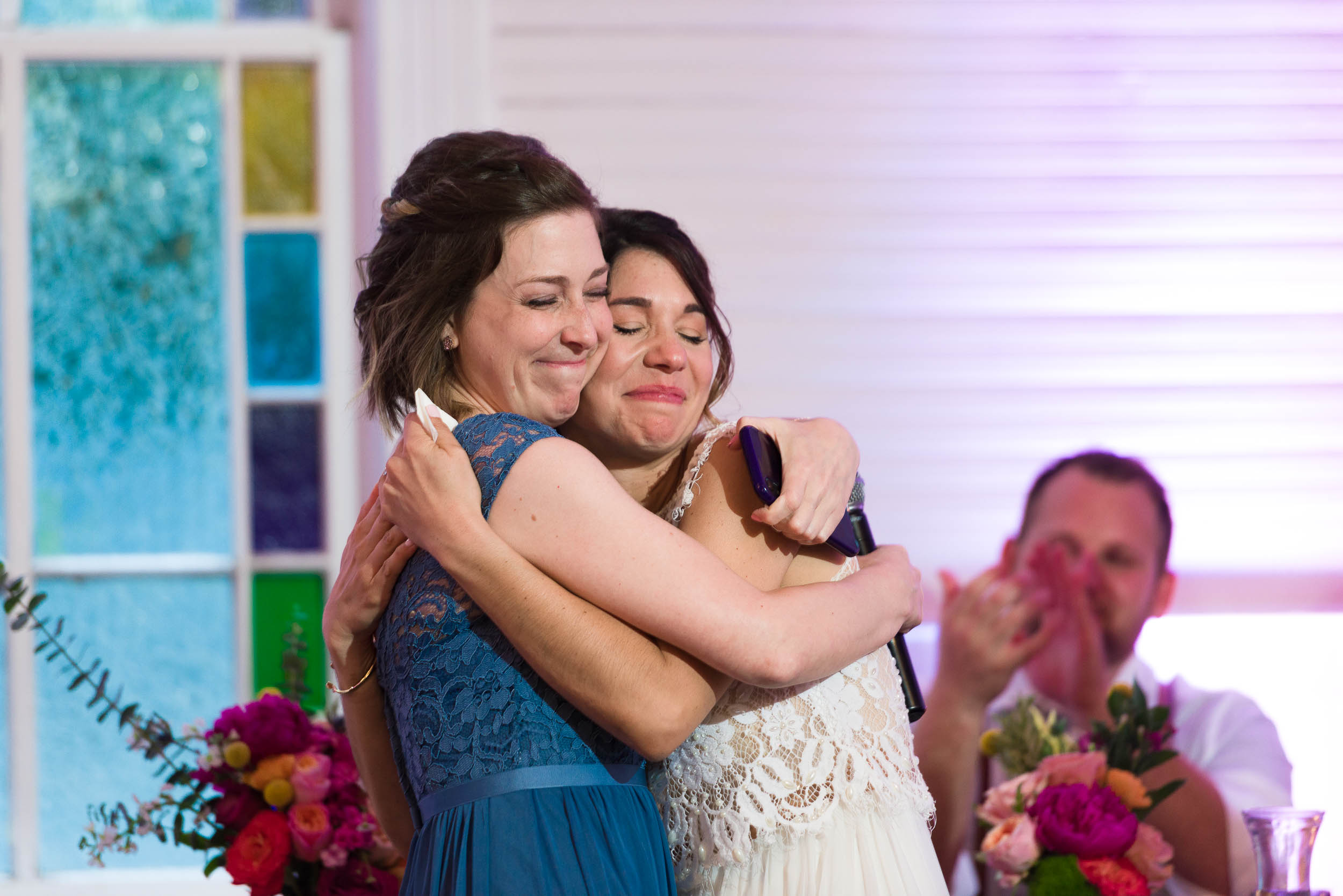 Reception-Austin-Wedding-Photographers-toasts-maid-honor-hug-bride-Mercury-Hall