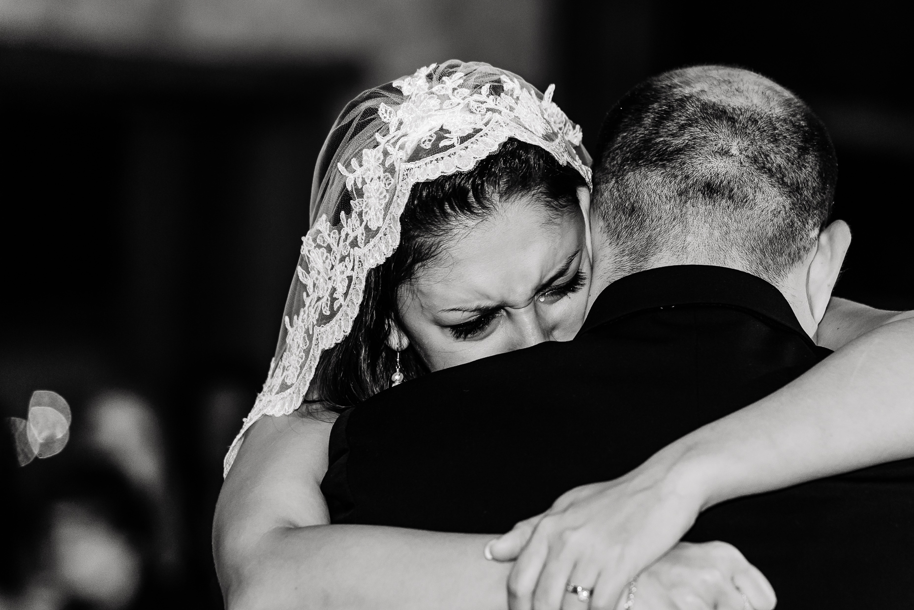 Austin-Wedding-Photographer-Embrace-Bride-Crying-Tear.jpg