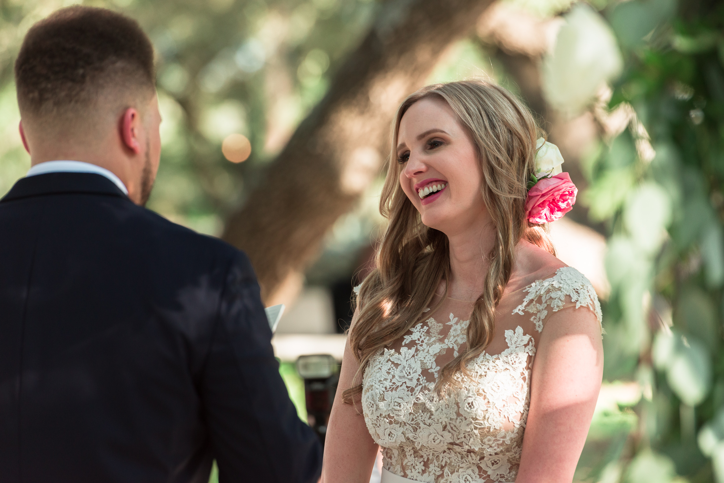 austin-wedding-photographers-ceremony-outdoor-addison-grove-laughter