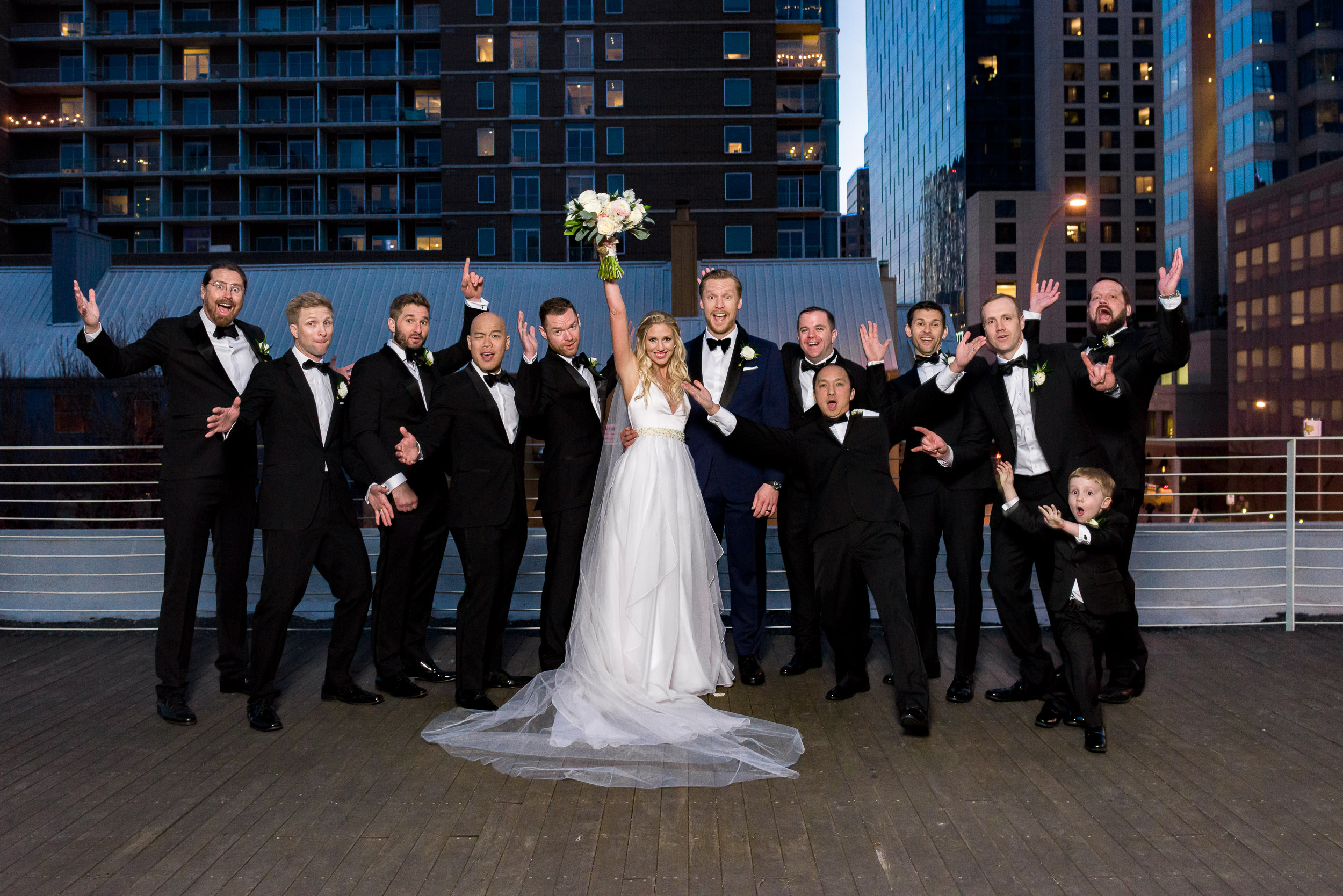 groomsmen-bride-portrait-rooftop-deck-Austin-wedding-photographers-brazos-hall-downtown