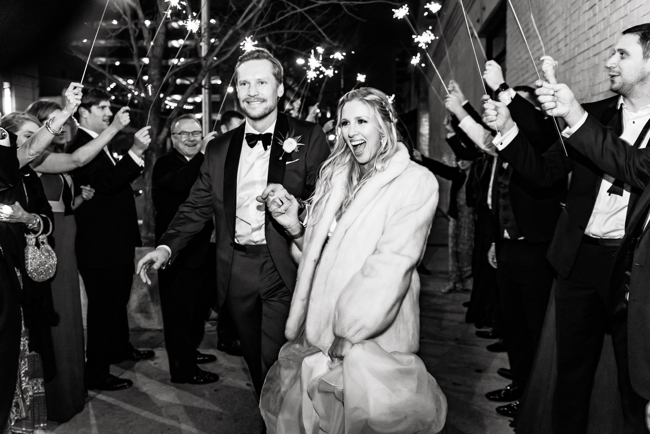 sparkler-exit-fur-tuxedo-winter-Austin-wedding-photographers-brazos-hall-downtown