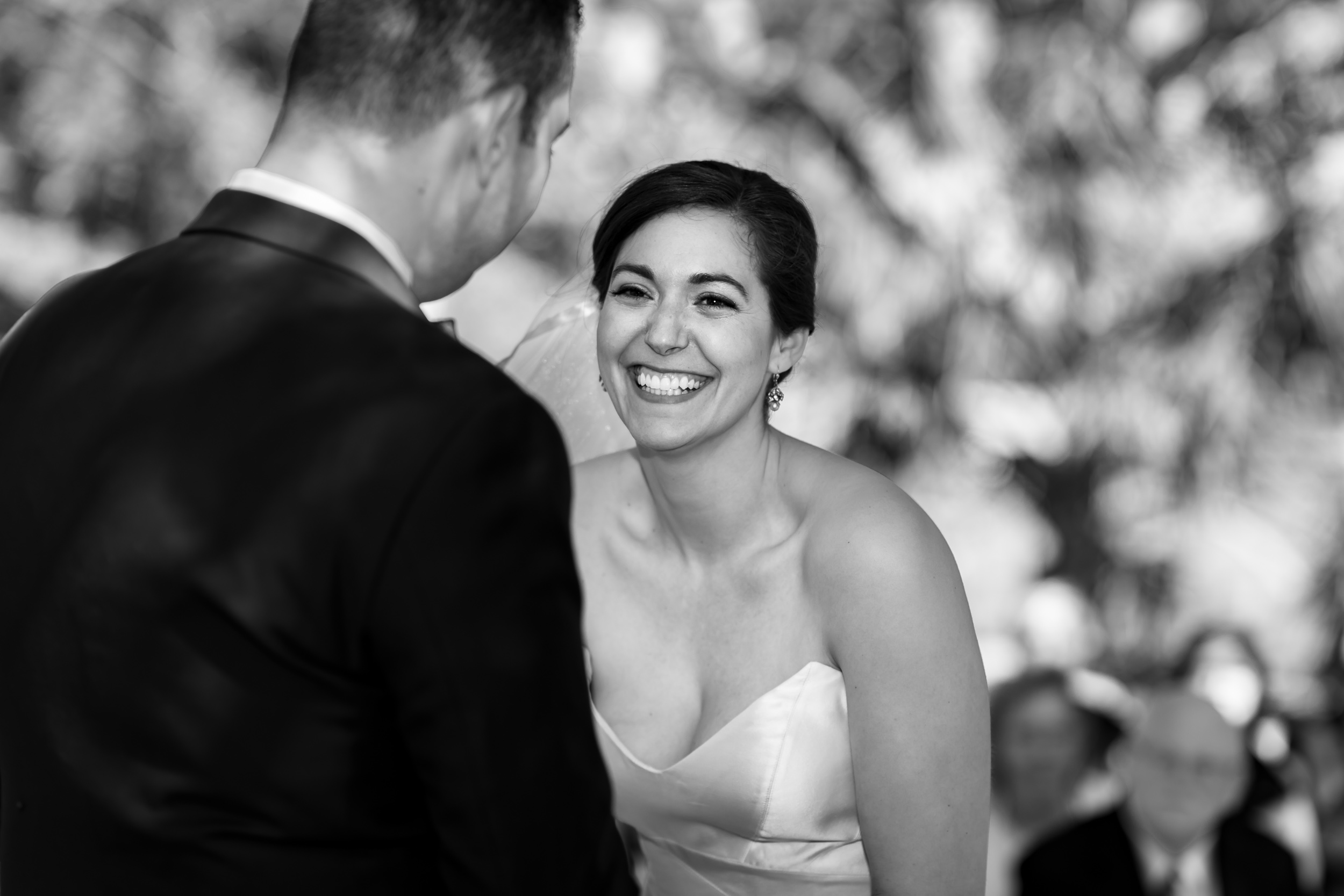 texas-austin-wedding-photographers-ceremony-bride-laughing-east-eden-farm